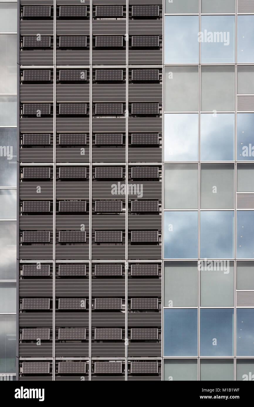 Solar cell panels on the side of a building in Shinjuku, Tokyo, Japan. Friday January 19th 2018 - Stock Image