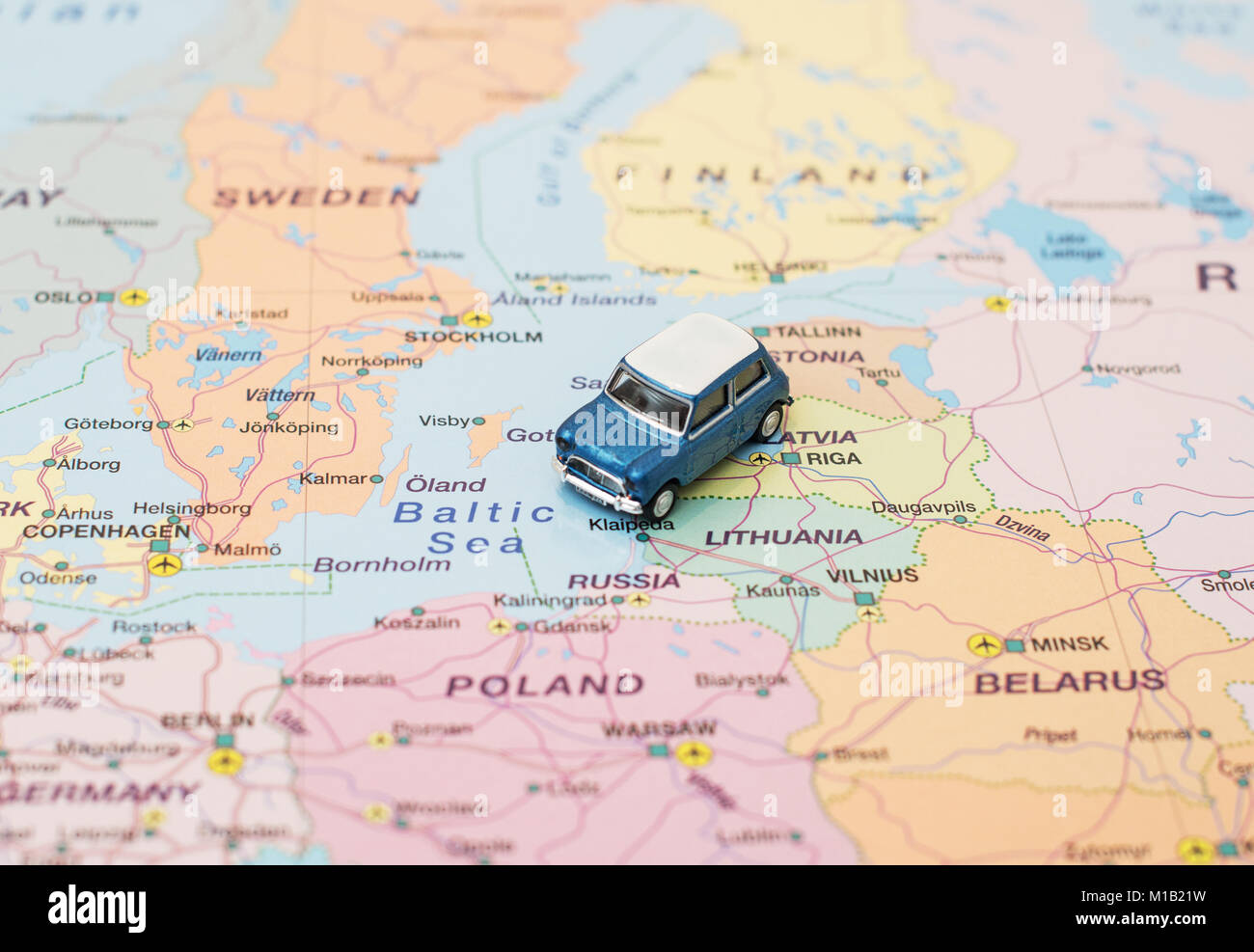 Concept of Europe car trip. Car is on the map in Baltic States. Stock Photo