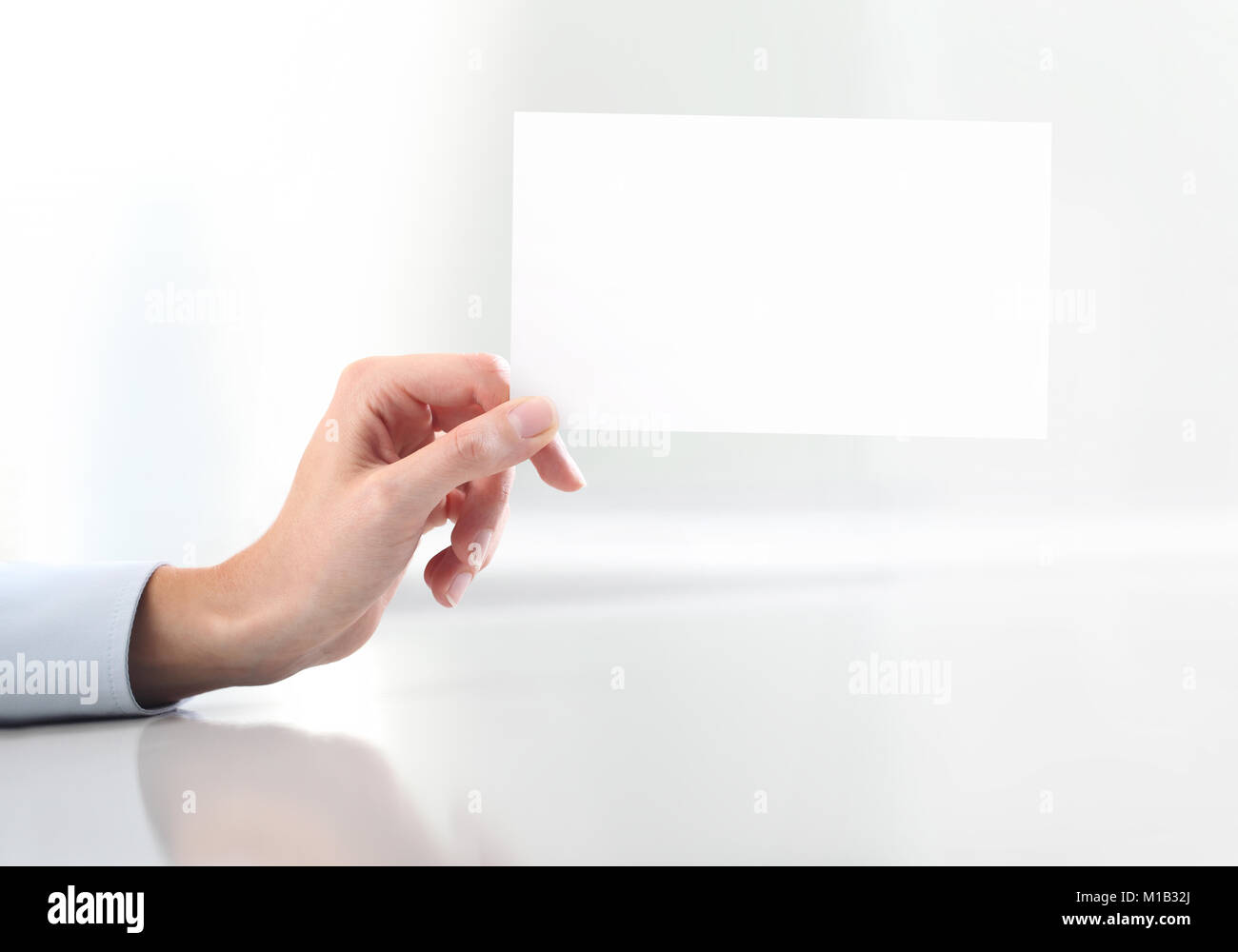 Hand hold blank business card Stock Photo: 172962234 - Alamy