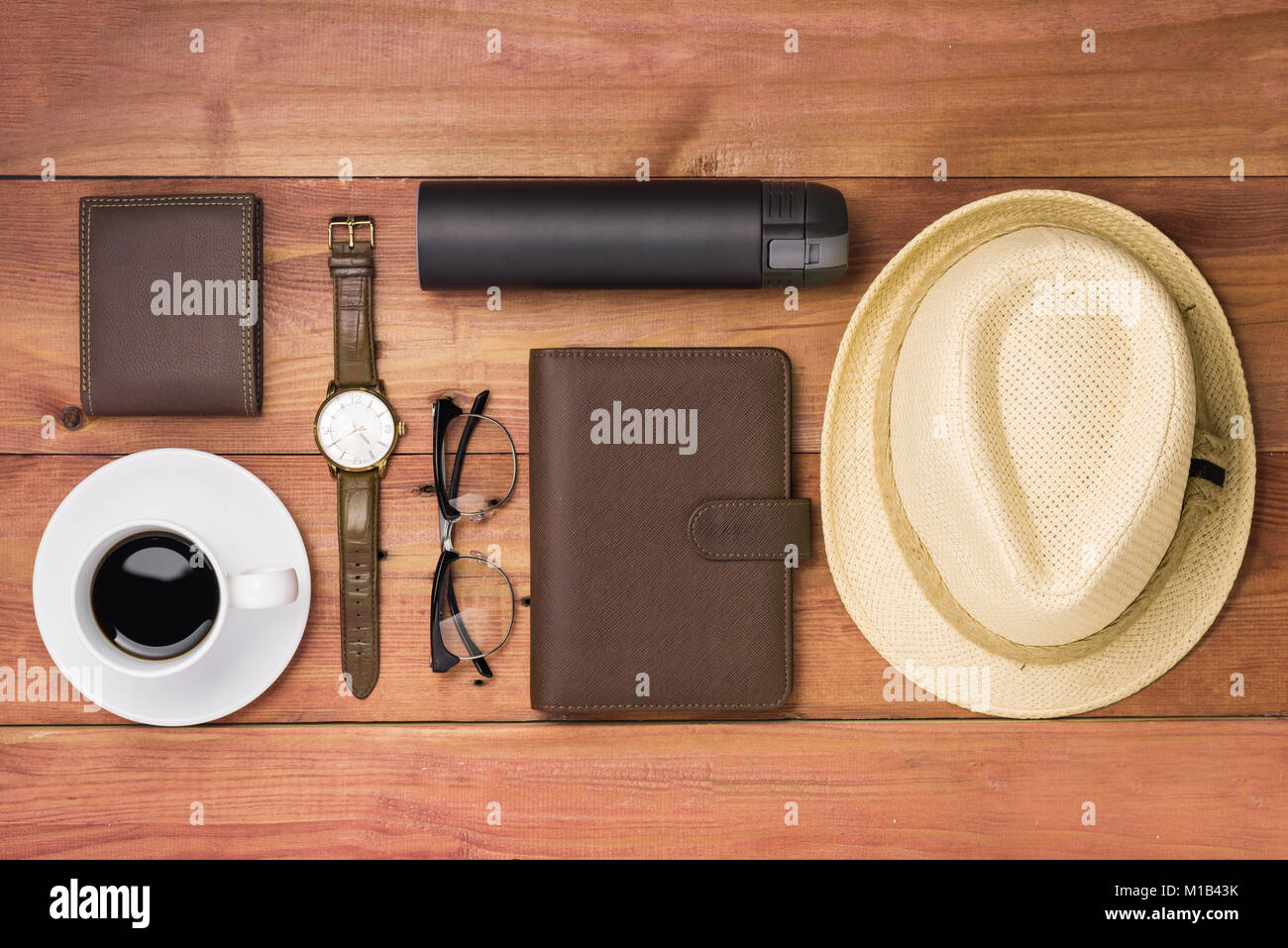 Men's casual outfits with man clothing and accessories on wooden background, Stock Photo