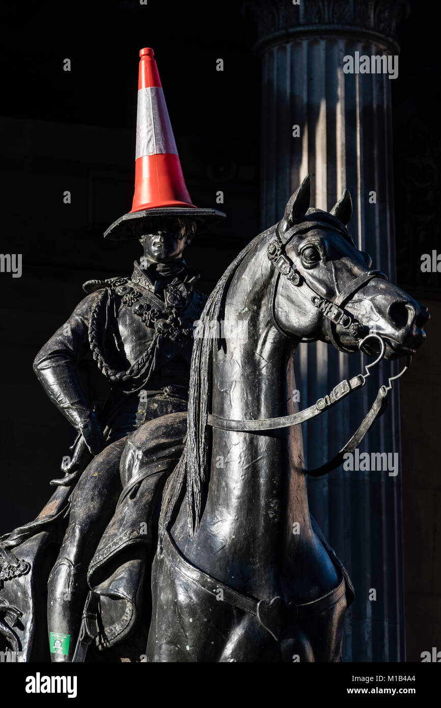 Statue of Wellington on horseback with traffic cone on his head at Gallery of Modern Art in Exchange Square, Glasgow, - Stock Image