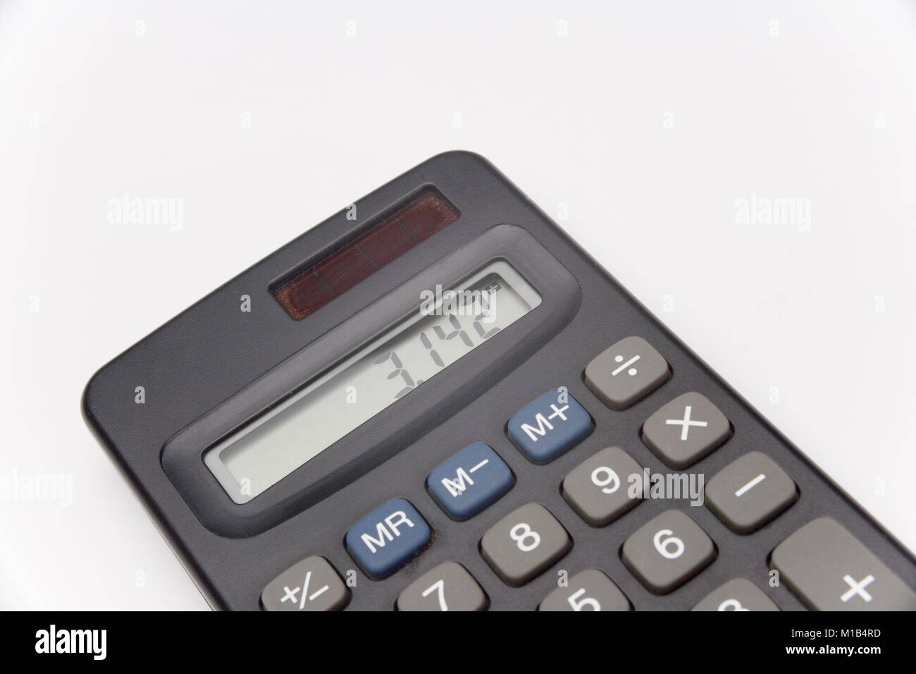 Calculator on white background showing value of pi Stock