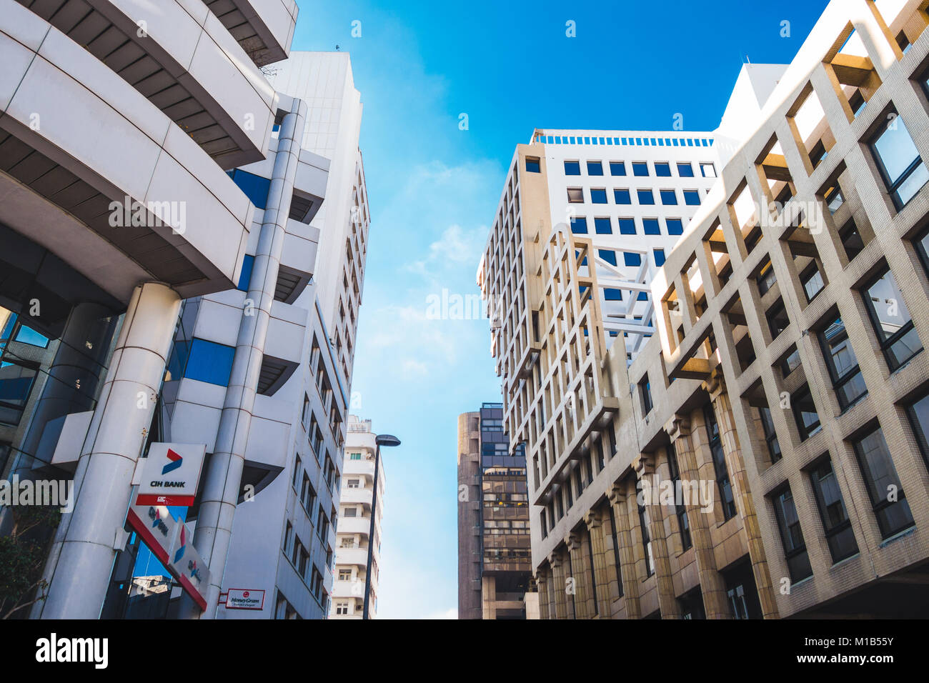 Casablanca, Morocco - 21 January 2018 : low angle view of CIH bank building and others in the financial district - Stock Image