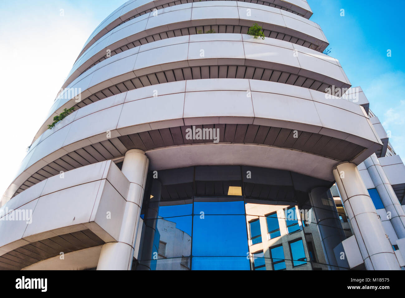 Casablanca, Morocco - 21 January 2018 : low angle view of CIH bank building in the financial district - Stock Image