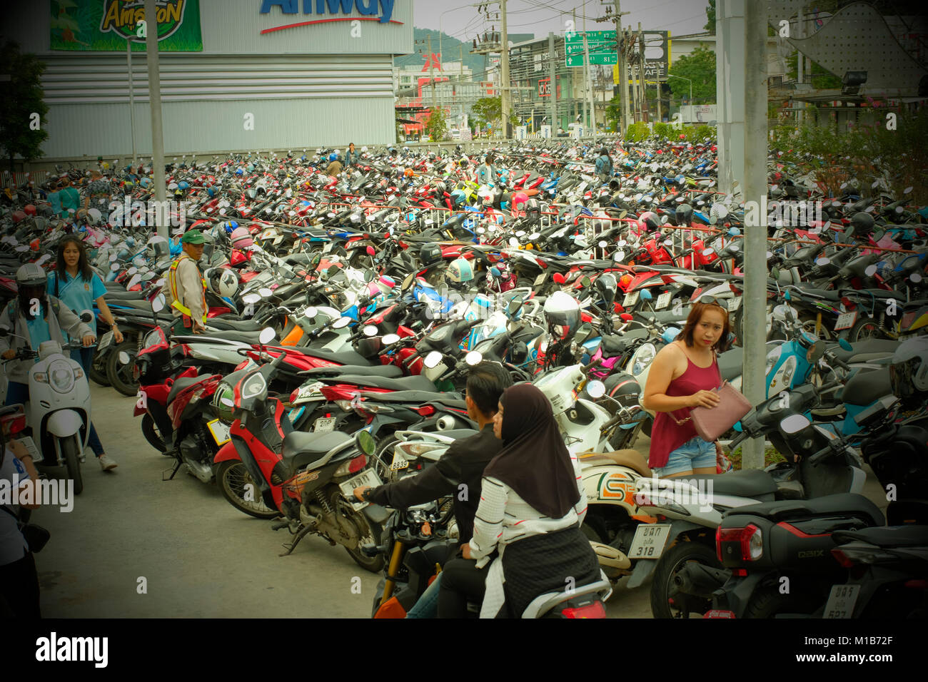Motorcycles parking near a shopping mall in Phuket, Thailand. - Stock Image