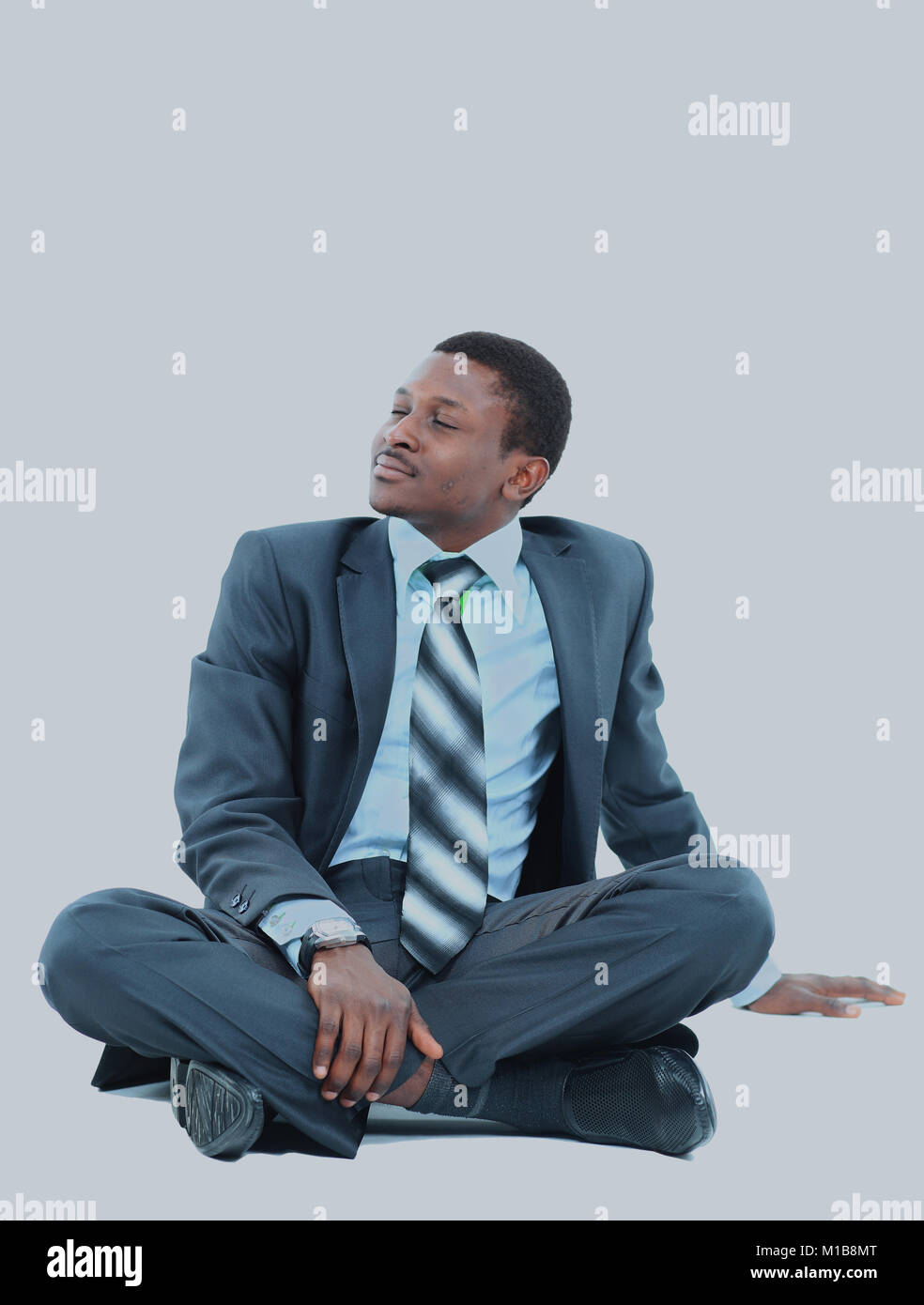 afro-american businessman relaxing. - Stock Image