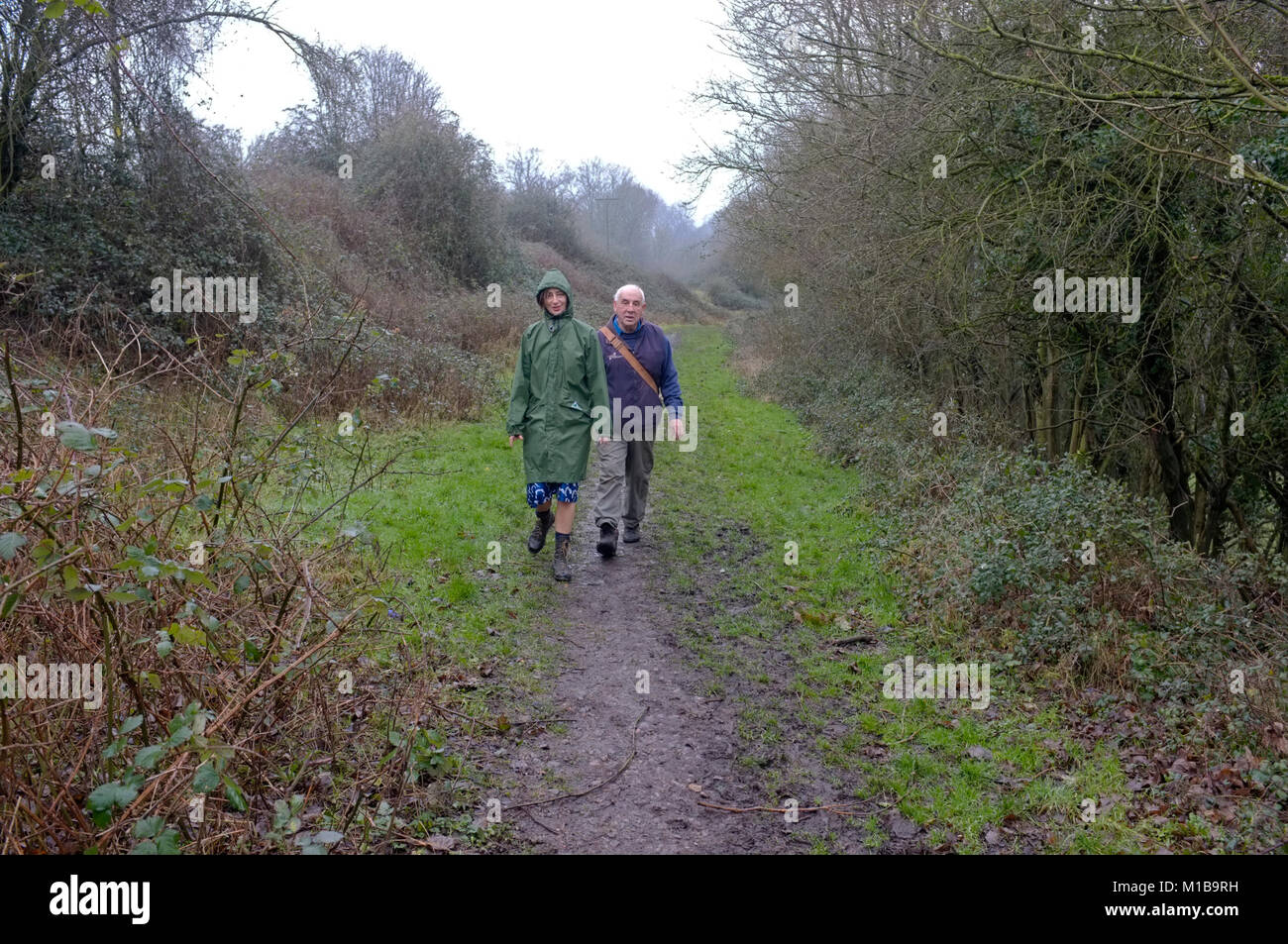 Father and daughter walking. - Stock Image