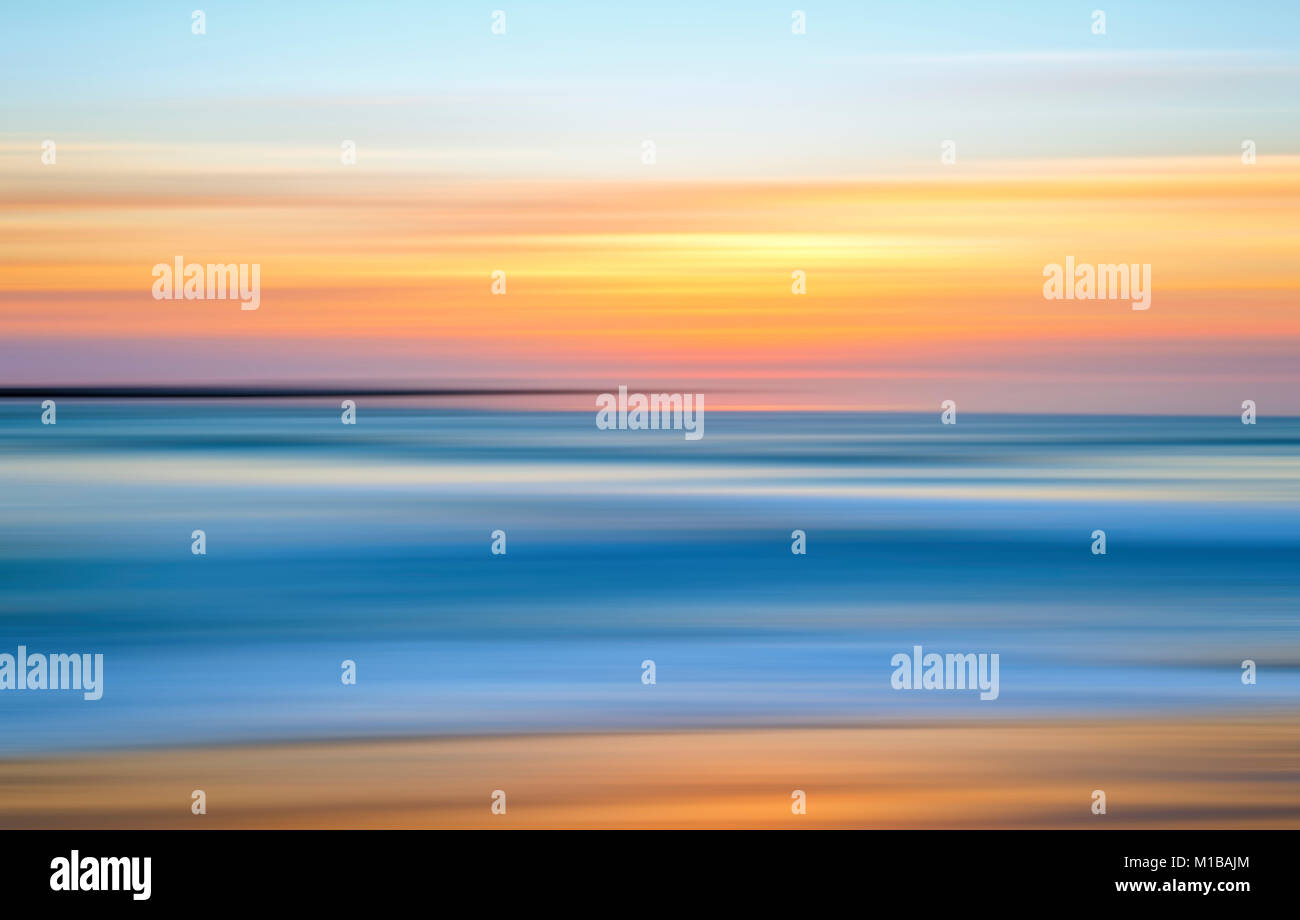 Coastal sunset with motion blur effect. - Stock Image