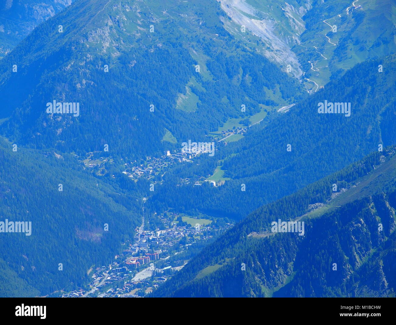 CHAMONIX MONT BLANC village in valley seen from AIGUILLE du MIDI peak at french Alps - Stock Image