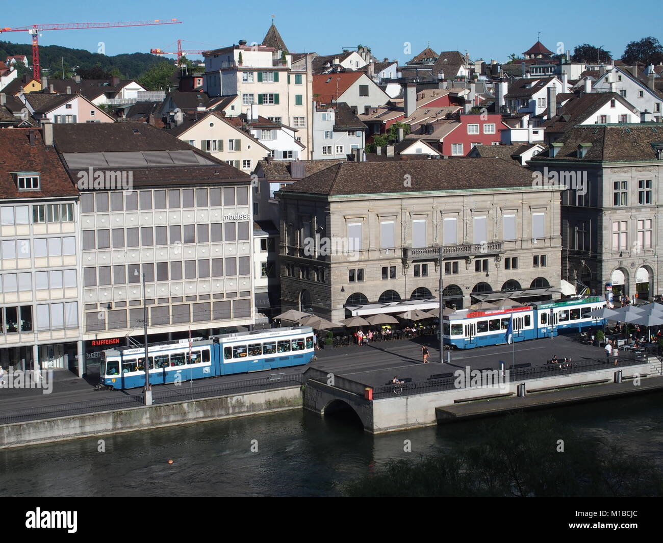Representative buildings on bank of Limmat river and cityscape of largest swiss Zurich city center - Stock Image
