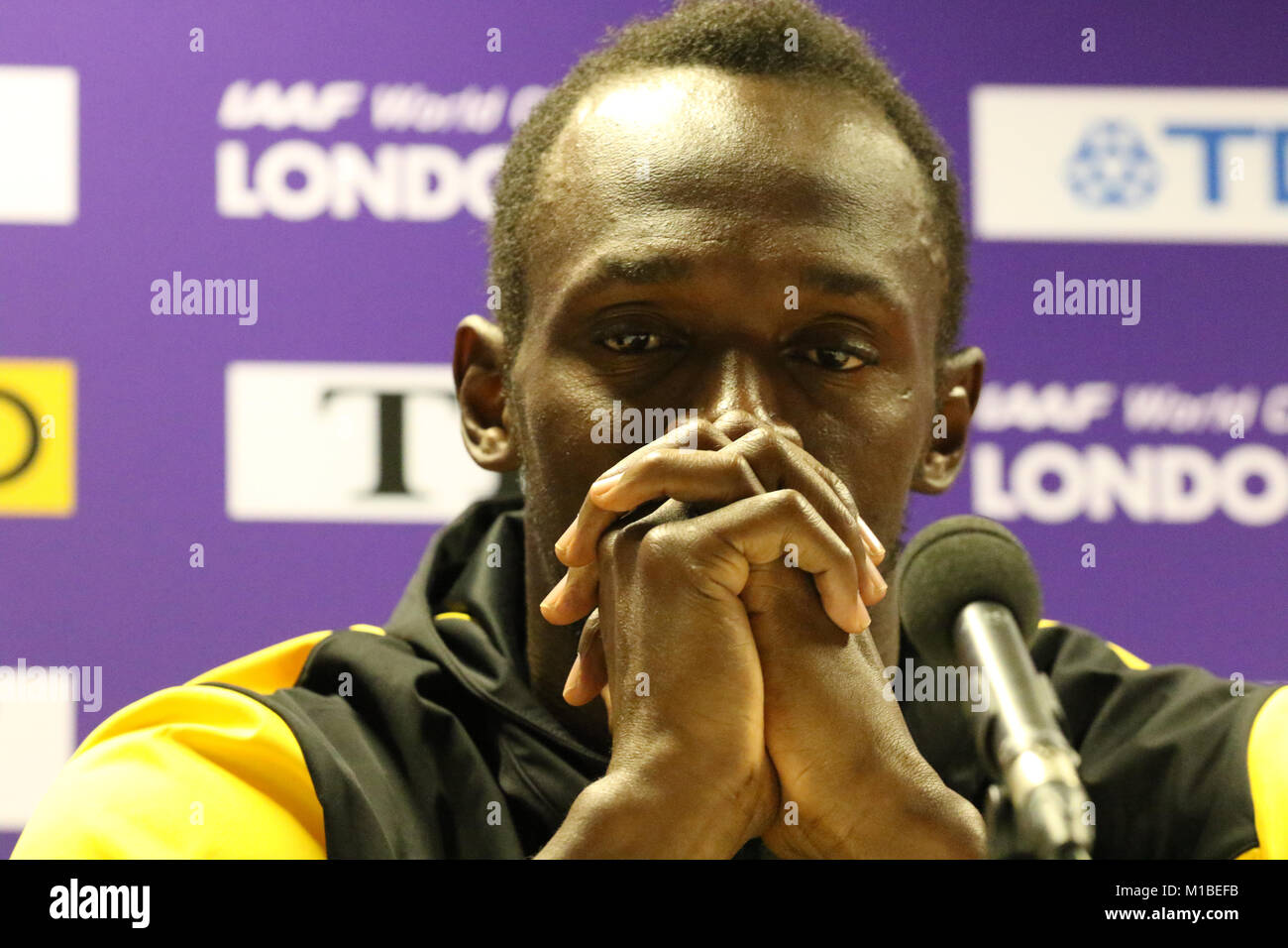 a sad looking Usain Bolt meets the press after finishing second at the IAAF World Athletics Championships. - Stock Image