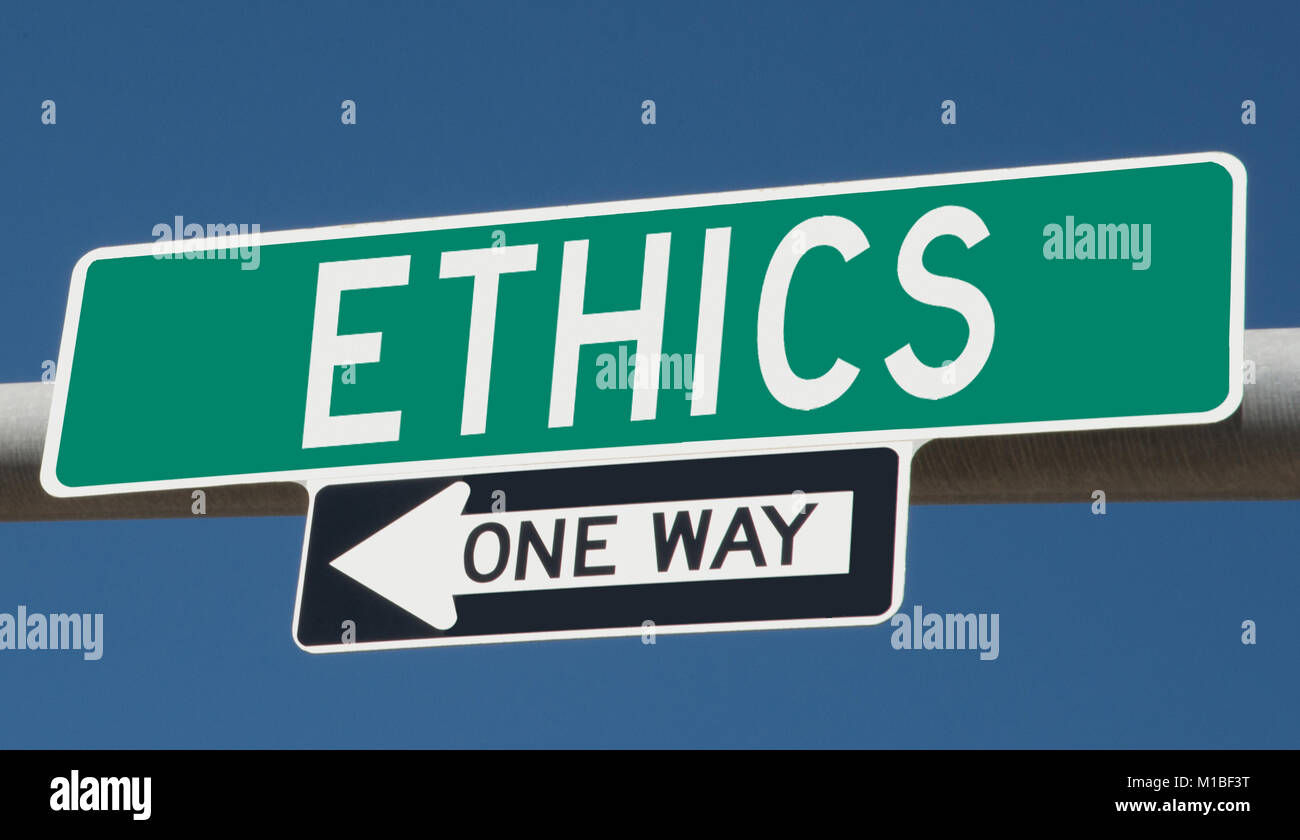 Ethics One Way green highway sign - Stock Image