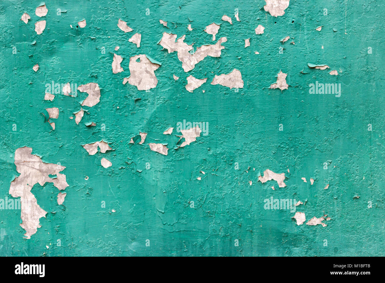 texture of rusty metal with an old peeling paint - Stock Image