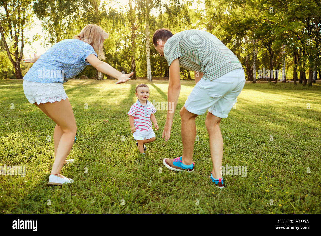 Happy family in nature.  - Stock Image