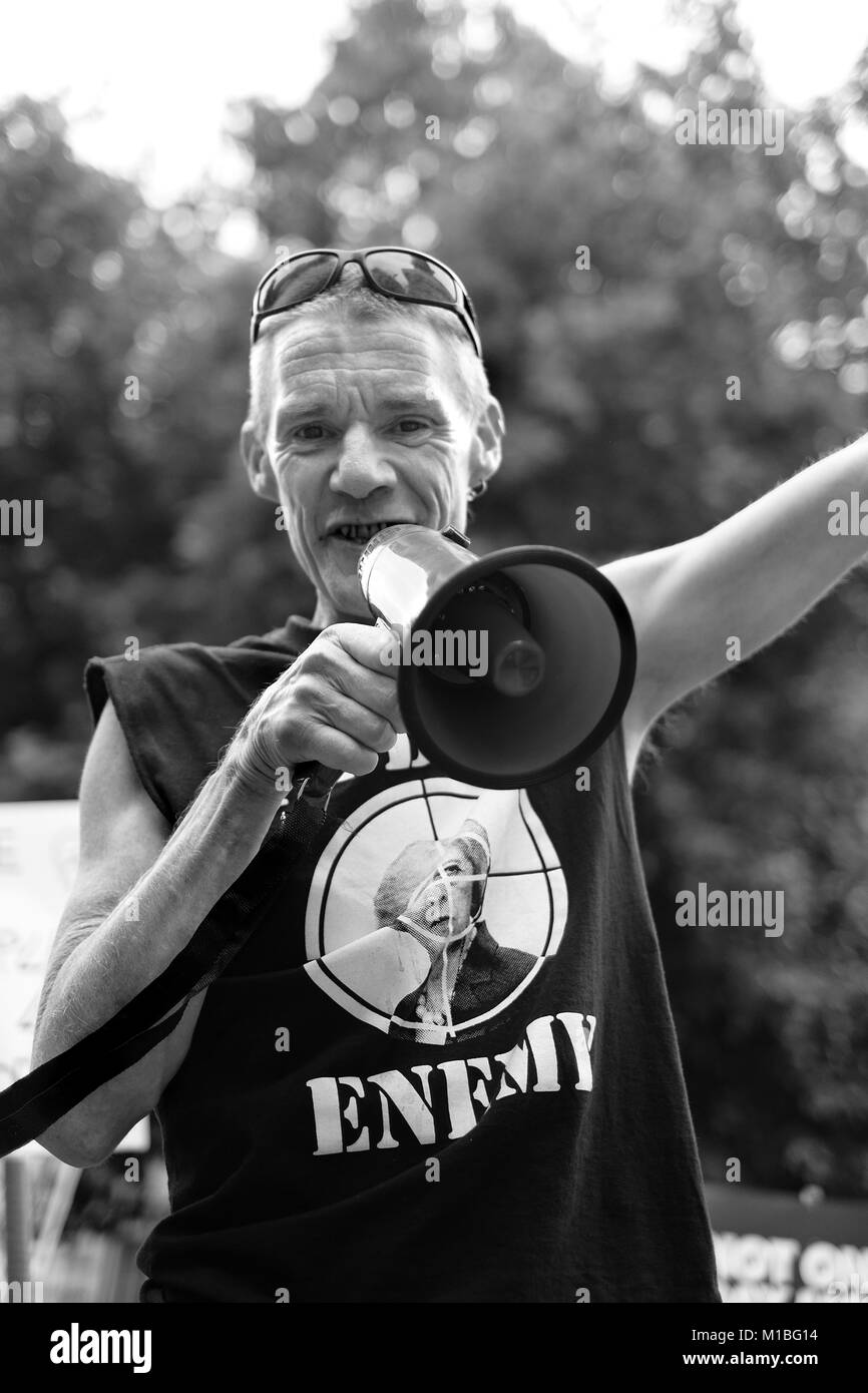 an anarcho-punk demonstrates with a megaphone at the Not one day more demonstration London Saturday 1 July 2017 - Stock Image