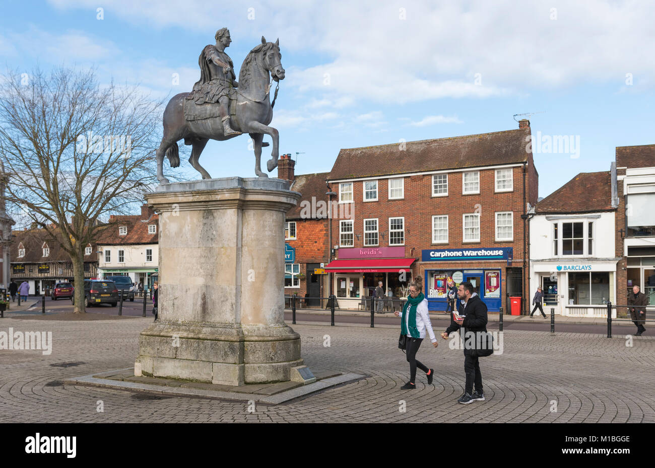 Statue of King William III on a horse on a stone plinth in the town square of Petersfield, Hampshire, England, UK. - Stock Image