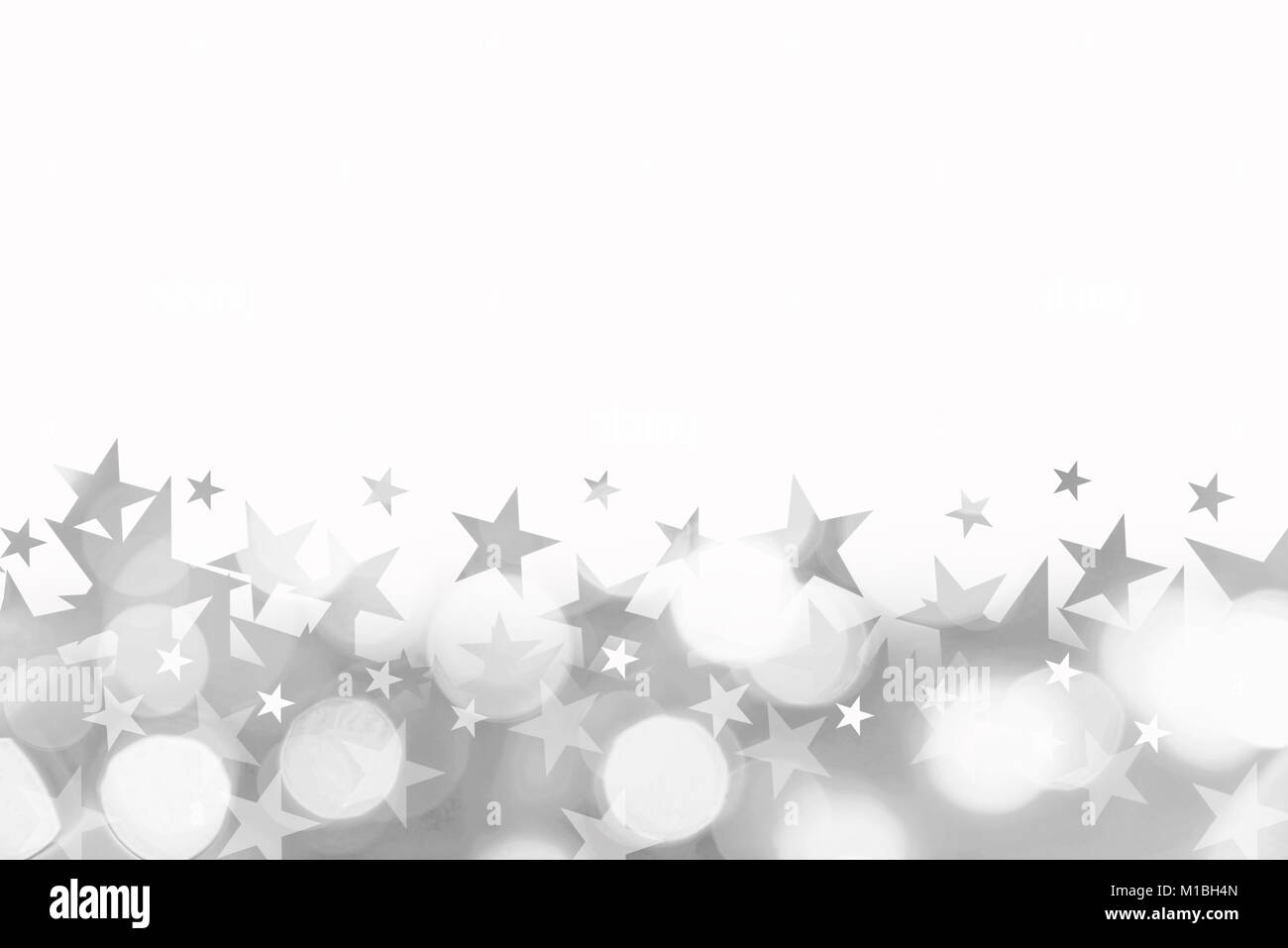 Shiny background of silver bokeh lights with stars isolated on white - Stock Image