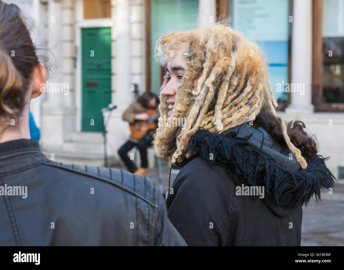 Young man with dreadlocks or braided hair. - Stock Image