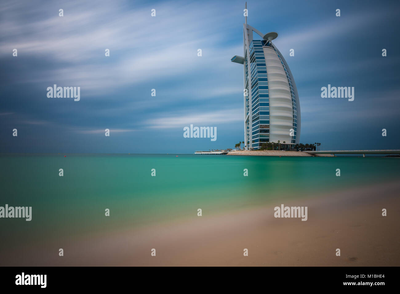 Views of the luxury beachfront hotel Burj Al Arab located on a man-made island in Dubai, UAE, United Arab Emirates - Stock Image