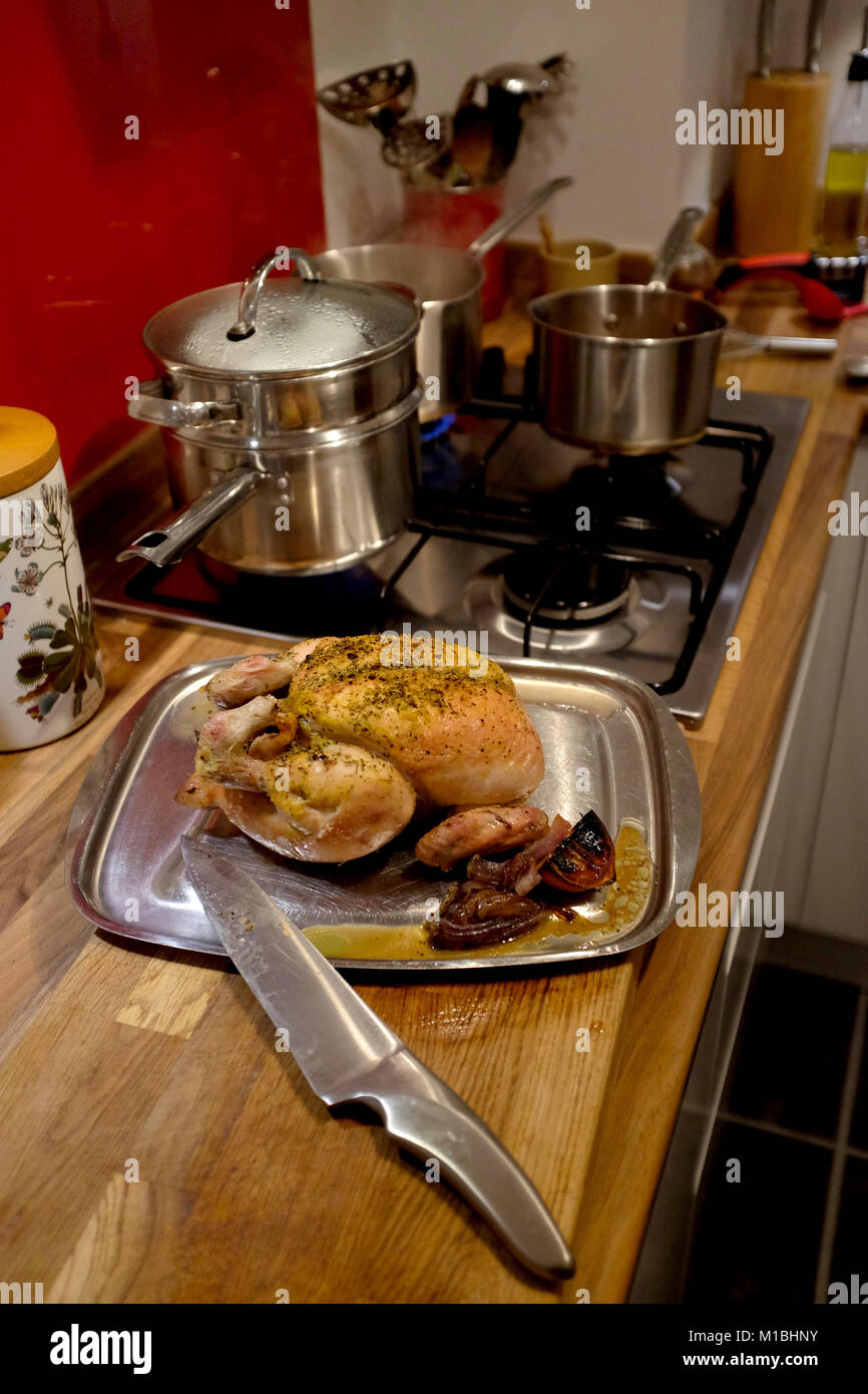 Home cooked roast chicken for Sunday lunch ready for carving - Stock Image