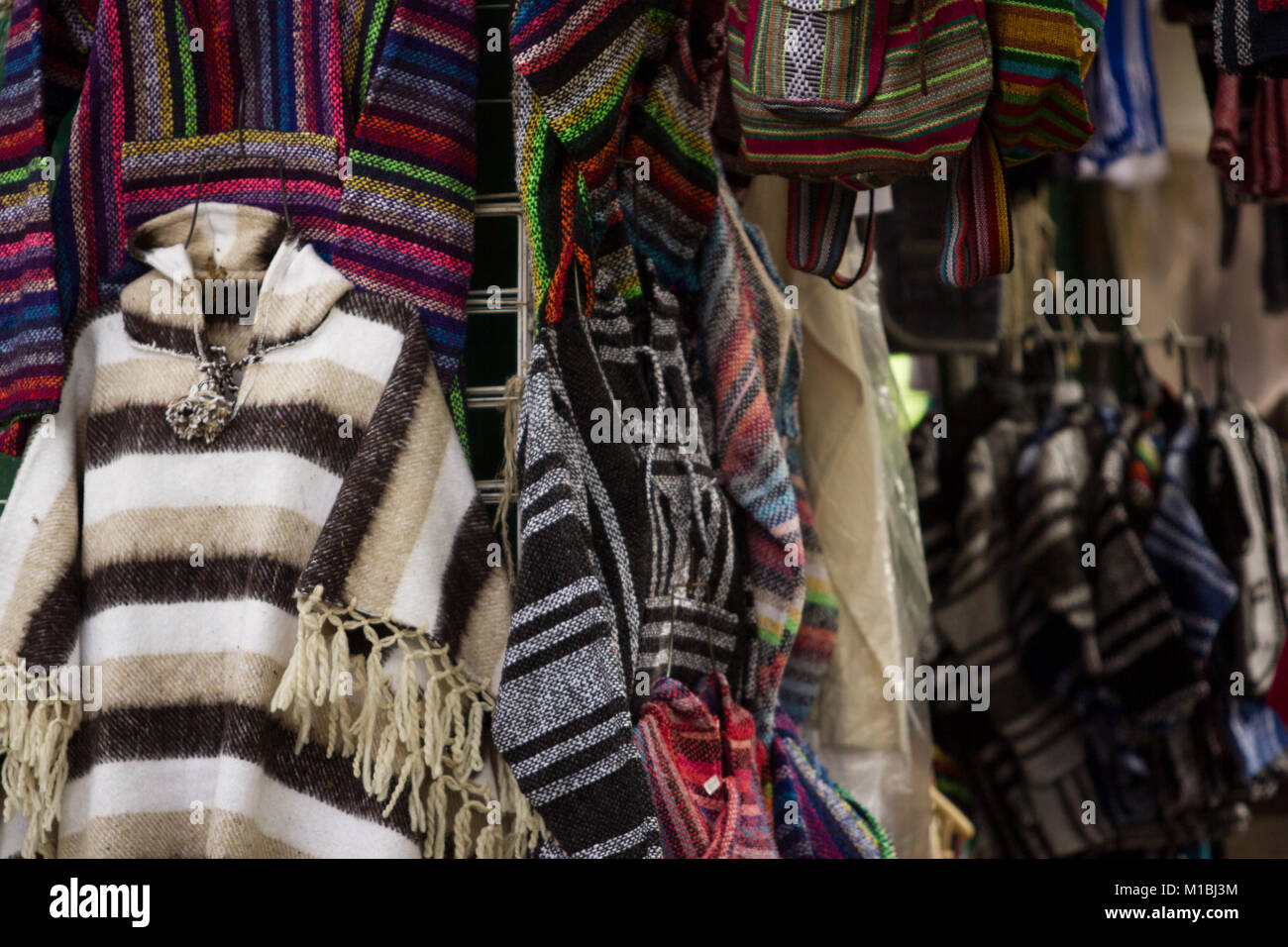 Mexican poncho in exhibition in the market - Stock Image