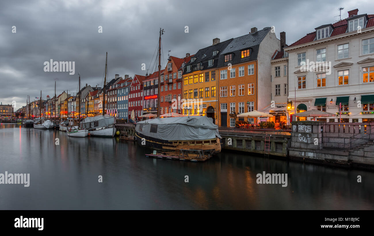 COPENHAGEN, DENMARK - FEBRUARY 28, 2017: Nyhavn at night. A 17th-century waterfront, canal and entertainment district Stock Photo