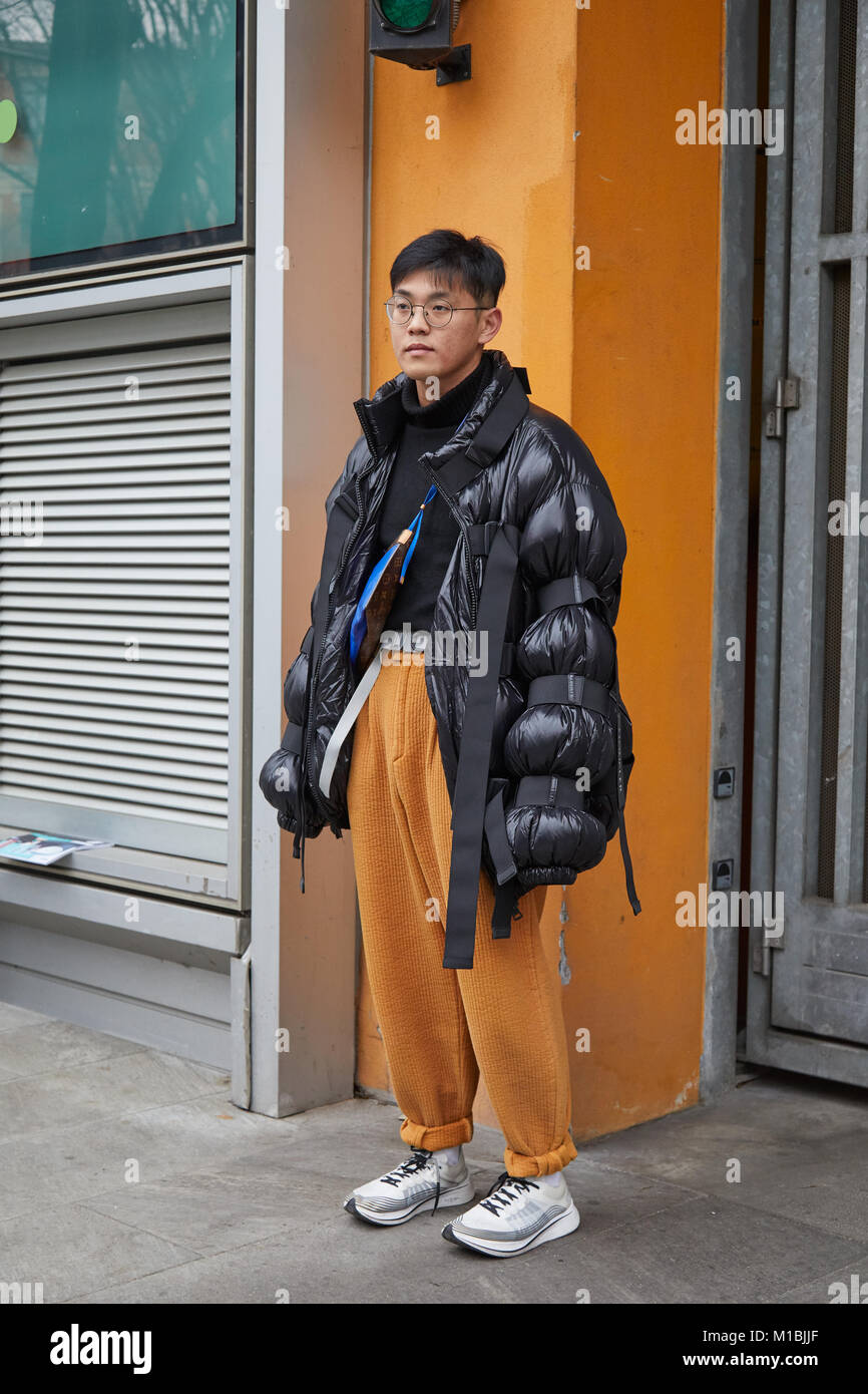 MILAN - JANUARY 15  Man with black Moncler padded jacket and yellow trousers  before Giorgio Armani fashion show 35b1882ca