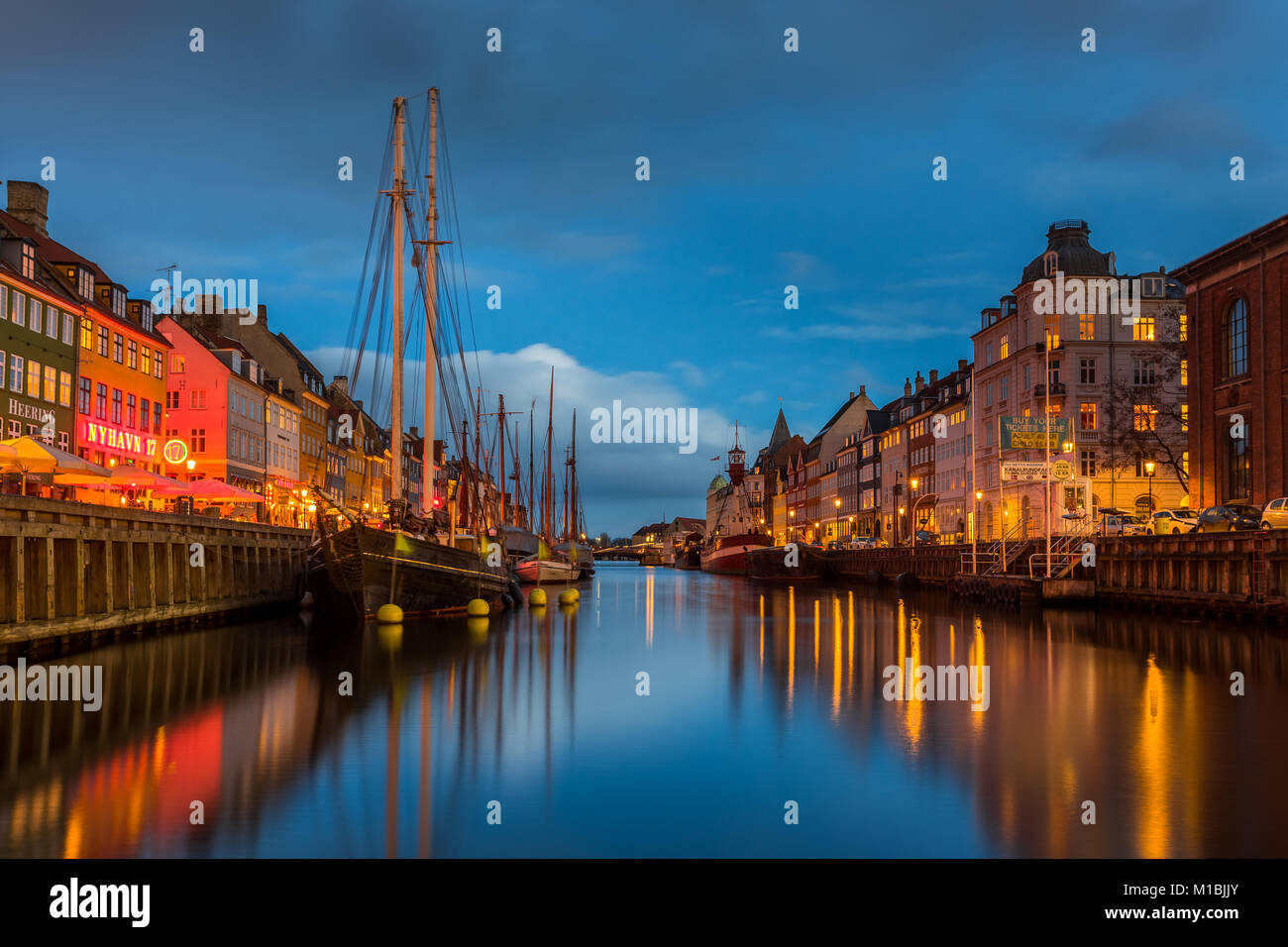 COPENHAGEN, DENMARK - FEBRUARY 28, 2017: Nyhavn at night. A 17th-century waterfront, canal and entertainment district - Stock Image