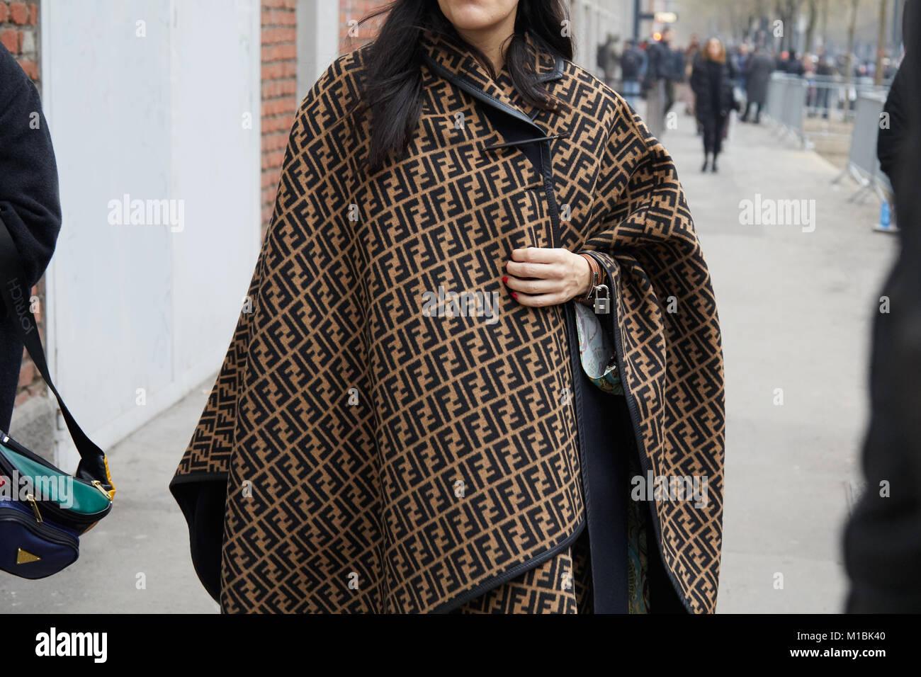 MILAN - JANUARY 15: Woman with brown and black Fendi cloak before Fendi fashion show, Milan Fashion Week street - Stock Image