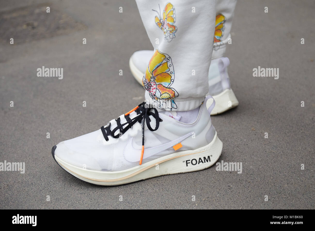 Man with white Nike foam shoes