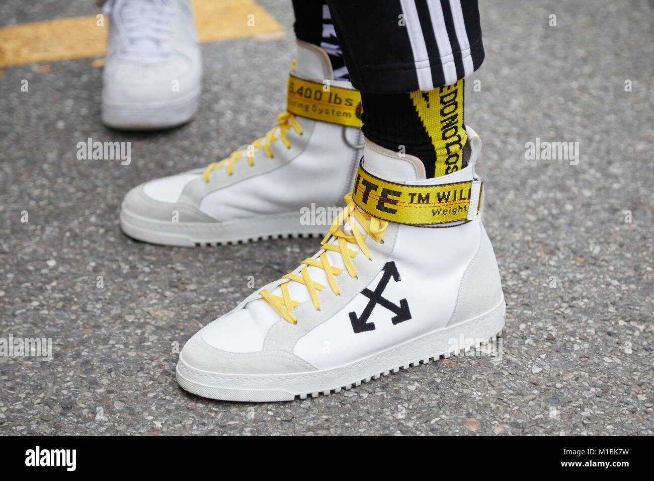 2762efd8f77e MILAN - JANUARY 15  Man with Off White sneakers with yellow belt before  Represent fashion show