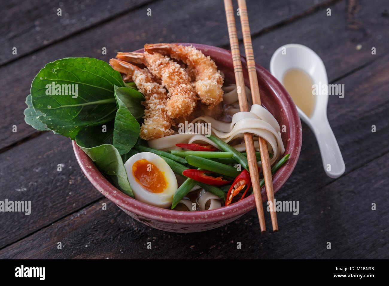 Tempura shrimps with asian noodle soup in a bowl Stock Photo