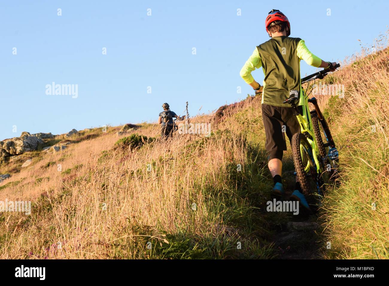 Jake Marsh Enduro Mountain Biking Pushing Up, Gwenver, Sennen, Cornwall, UK Stock Photo