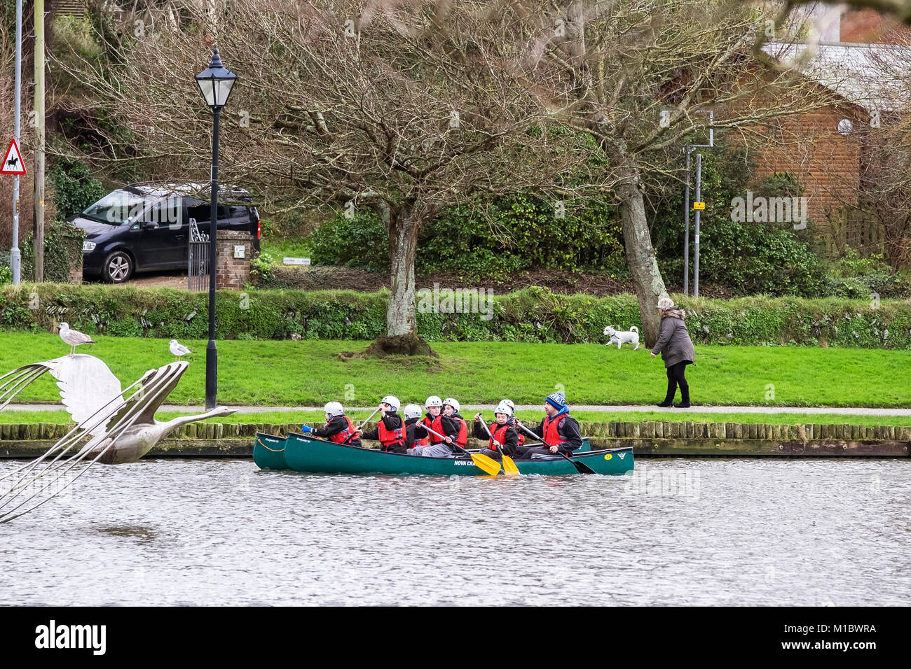Students kayaking on Trenance Lake in Newquay Cornwall. - Stock Image