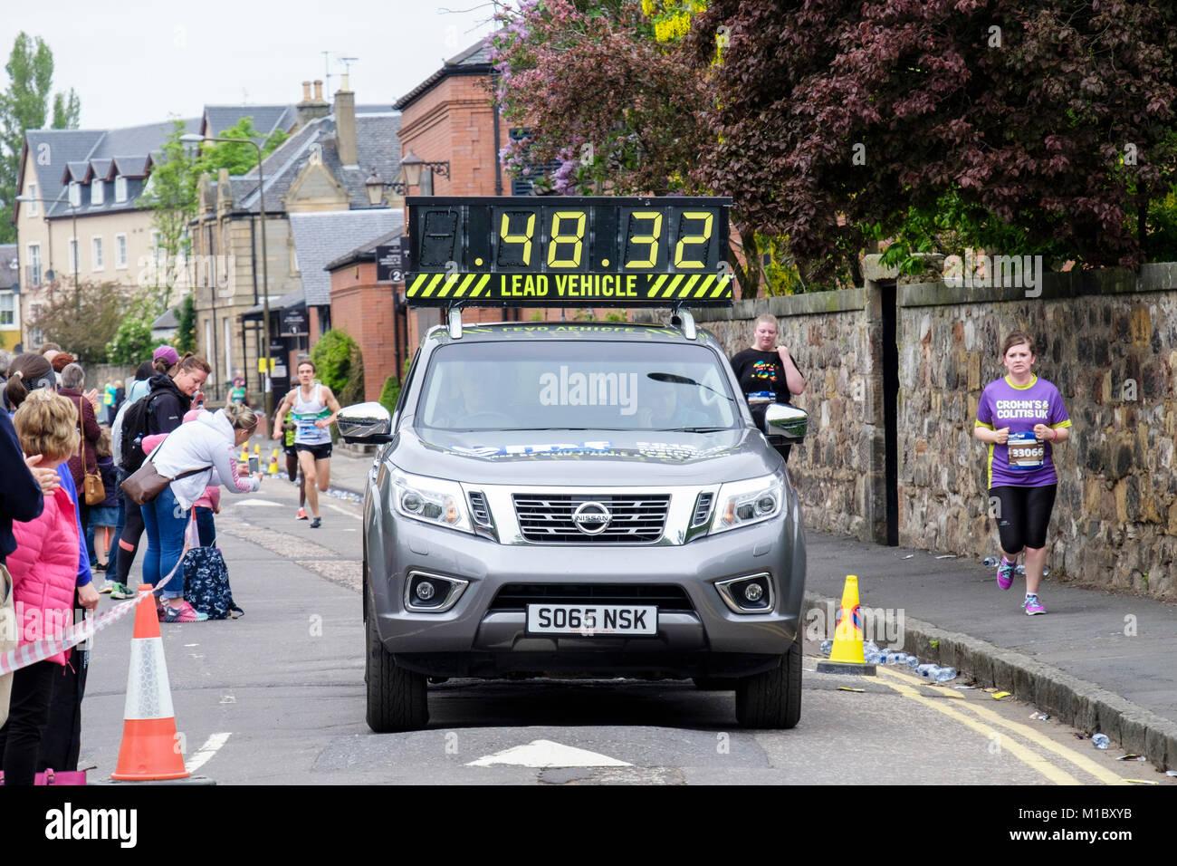 Lead vehicle in the Edinburgh marathon 2016 with spectators on roadside. Linkfield Road, Musselburgh, Edinburgh, - Stock Image