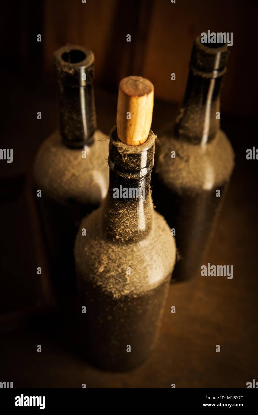 Still-life with three old wine bottles Stock Photo