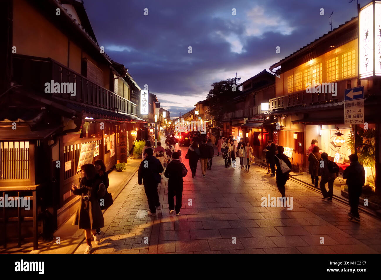 People at night on the busiest street in Gion district of Kyoto, Hanamikoji Dori, twilight old city scenery with Stock Photo