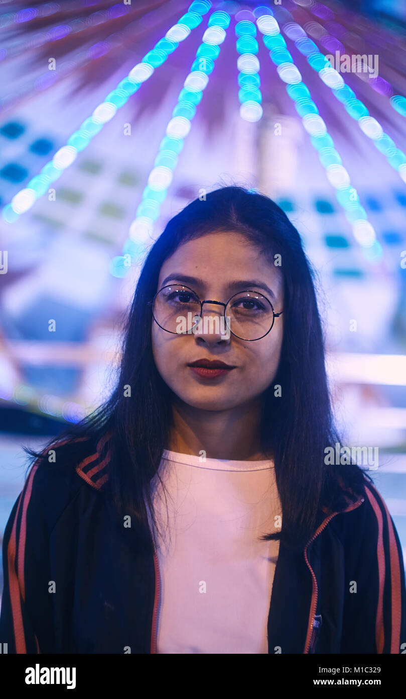 Young girl wearing eye glasses in Indian fair. - Stock Image