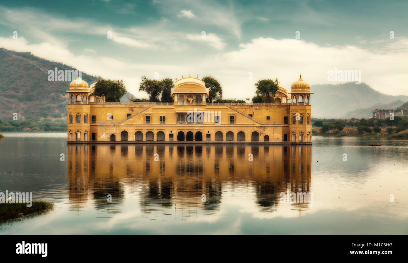 Jal Mahal water palace Jaipur Rajasthan moody sky and scenic landscape. A popular city architecture of Jaipur, India. - Stock Image