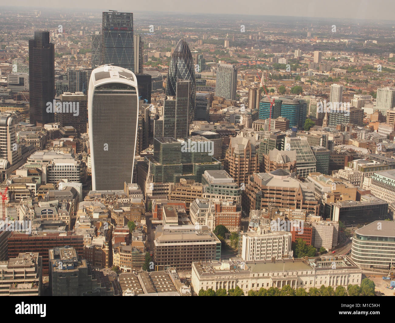 A view from the top viewing floor of The Shard, London, looking across the River Thames to the City of London - Stock Image