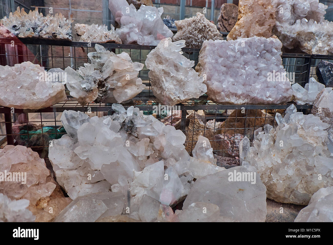 Crystal quartz mineral stones on the shelves in the local mountain shop Stock Photo