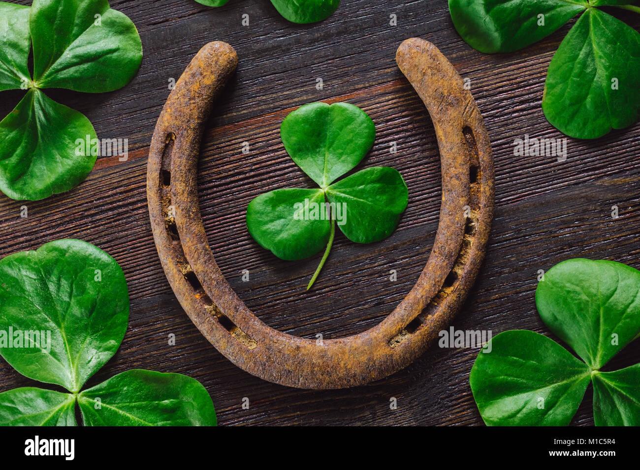 Lucky Horseshoe with Shamrocks Stock Photo