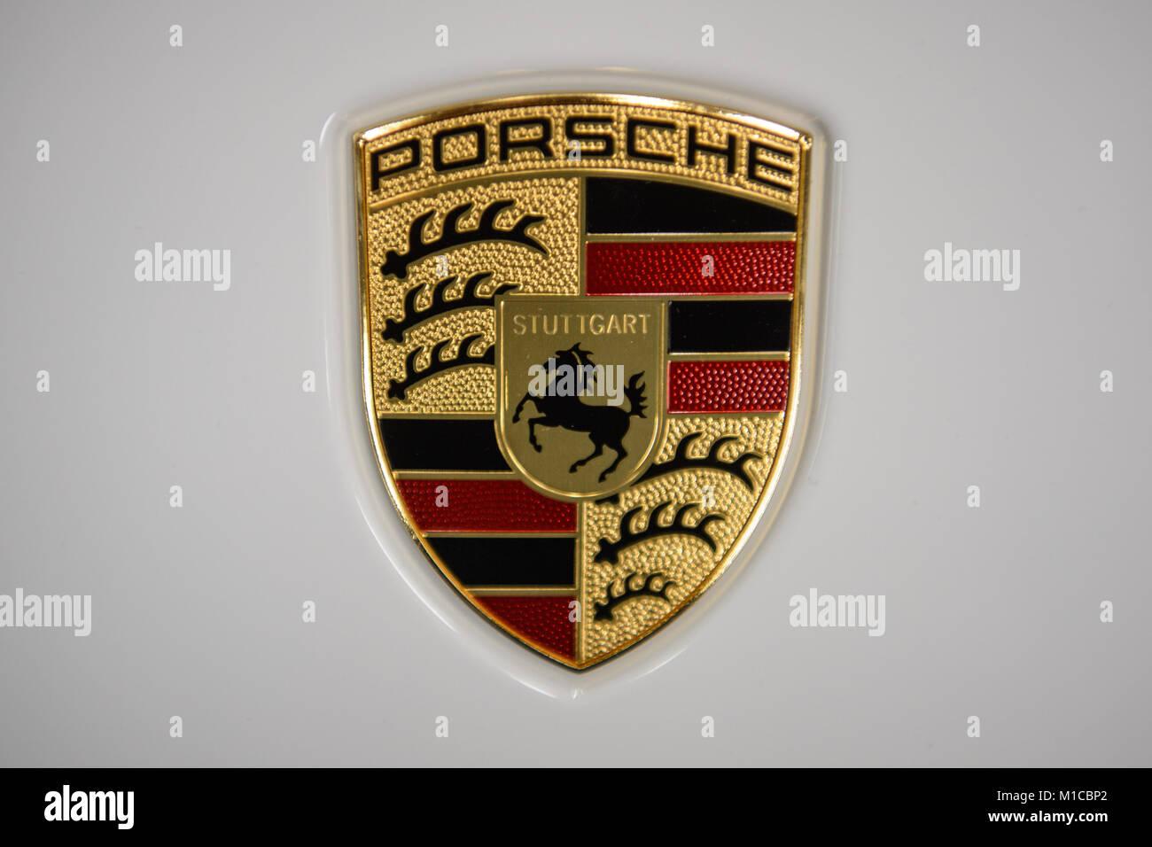 The Logo Of The German Automobile Company Porsche Decorates A Car At