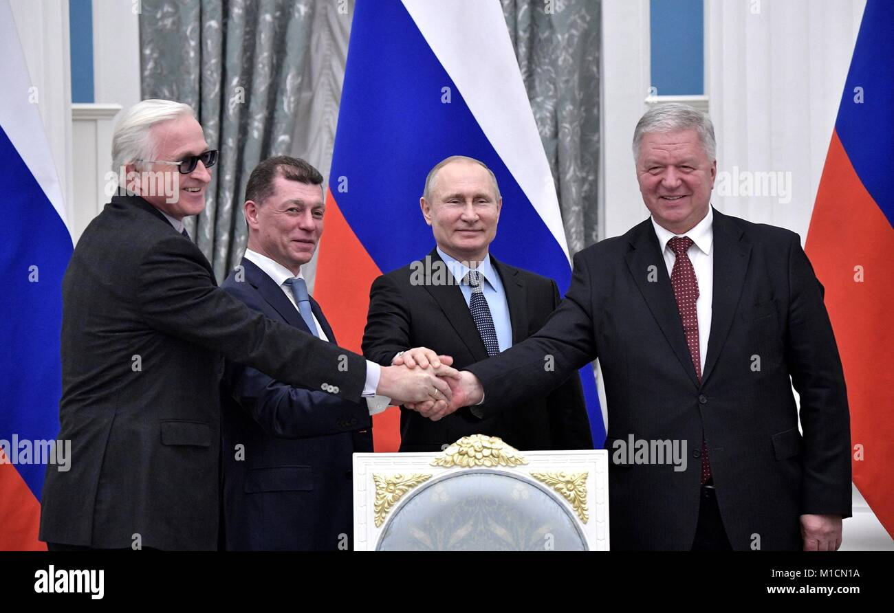 Federation of Independent Trade Unions of Russia Chairman Mikhail Shmakov, right, shakes hands with President of - Stock Image