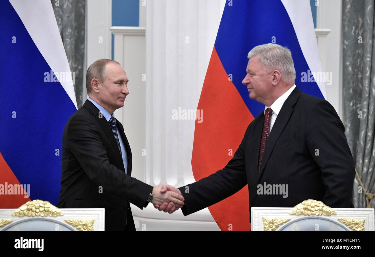 Russian President Vladimir Putin, left, shakes hands with the Federation of Independent Trade Unions of Russia Chairman - Stock Image