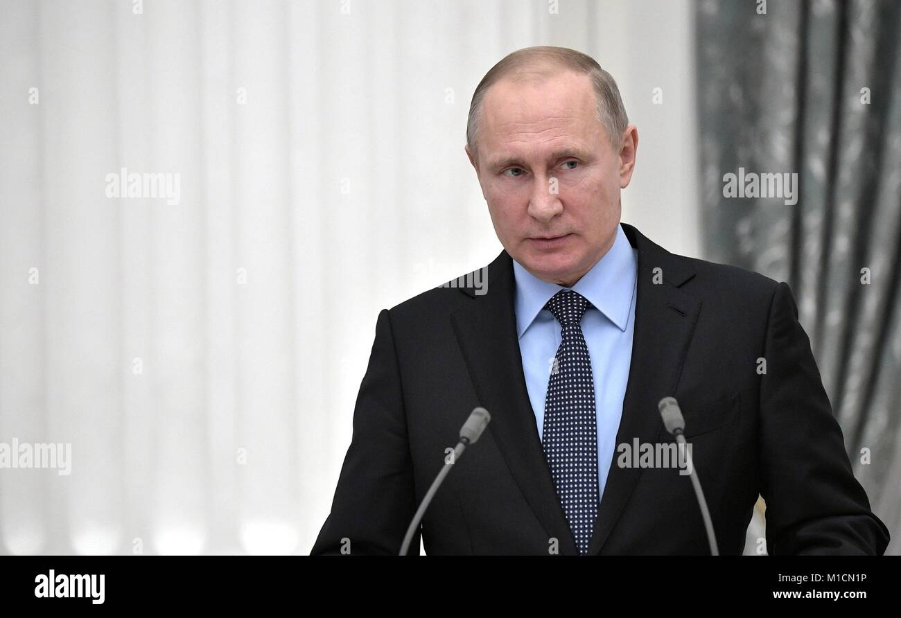 Russian President Vladimir Putin addresses attendees during a signing ceremony between Russian trade unions, employers - Stock Image