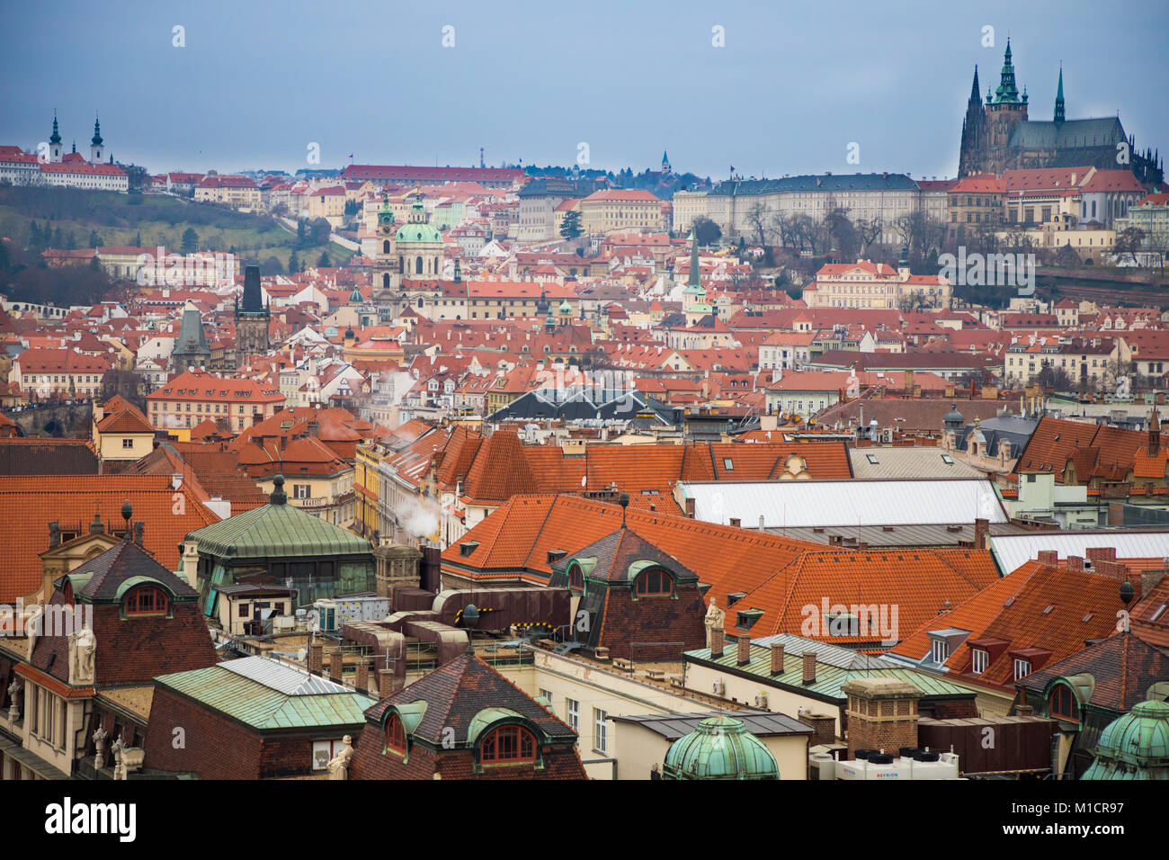 Prague castle and red roofs of old town in evening time, Czech Republic - Stock Image