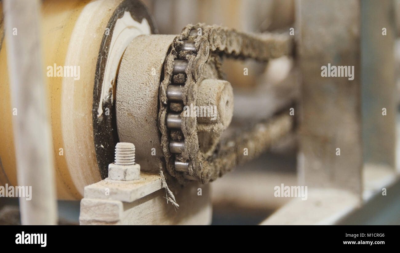 Rotated chain gear - part of industrial machinery - manufacturing - Stock Image