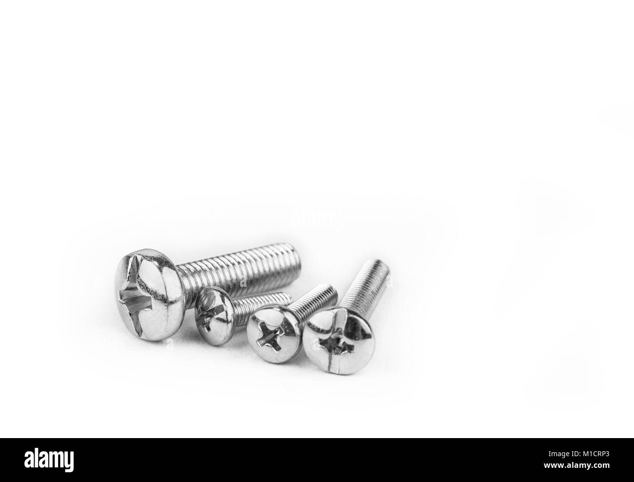 Screws and bolts for construction on the white background - Stock Image