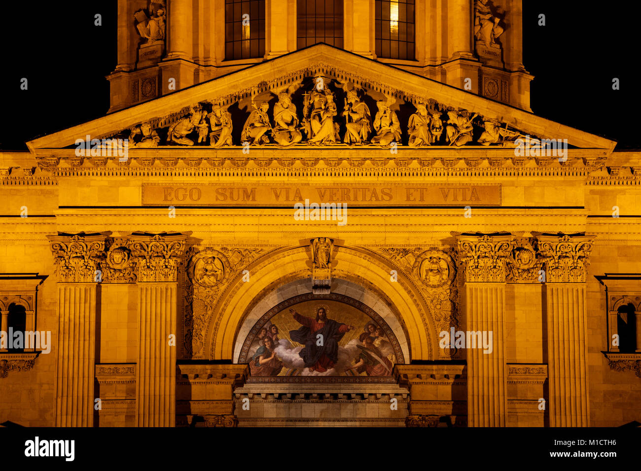 St. Stephen's Basilica in Budapest architectural details by night in Hungary, Europe, Latin inscription of Jesus - Stock Image